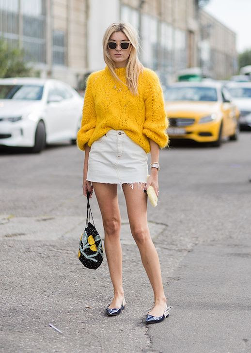 Le Fashion Blog Camille Charrière Sunglasses Yellow Chunky Sweater White Denim Mini Skirt Patterned Bag Black Flats Via Stylecaster