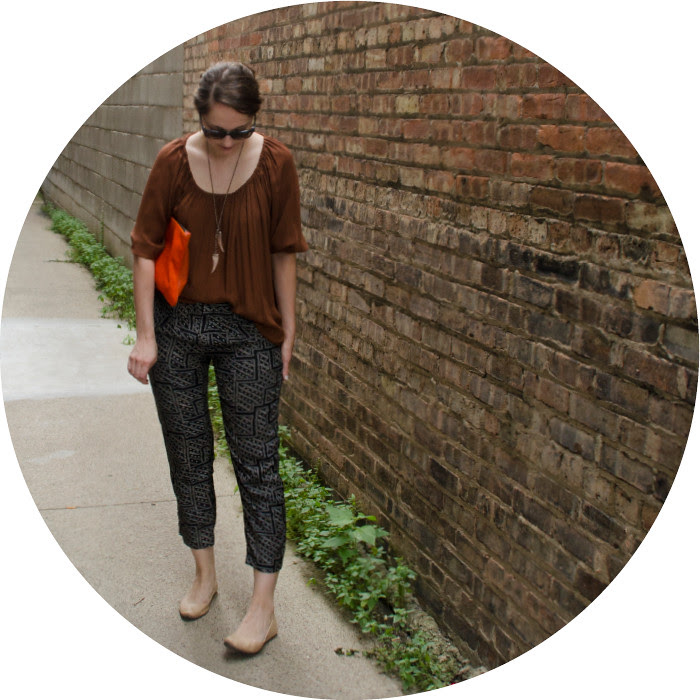 rust, print pants with blouse top, what to wear to work, navy and rust, orange clutch, talon necklace, joie silk top