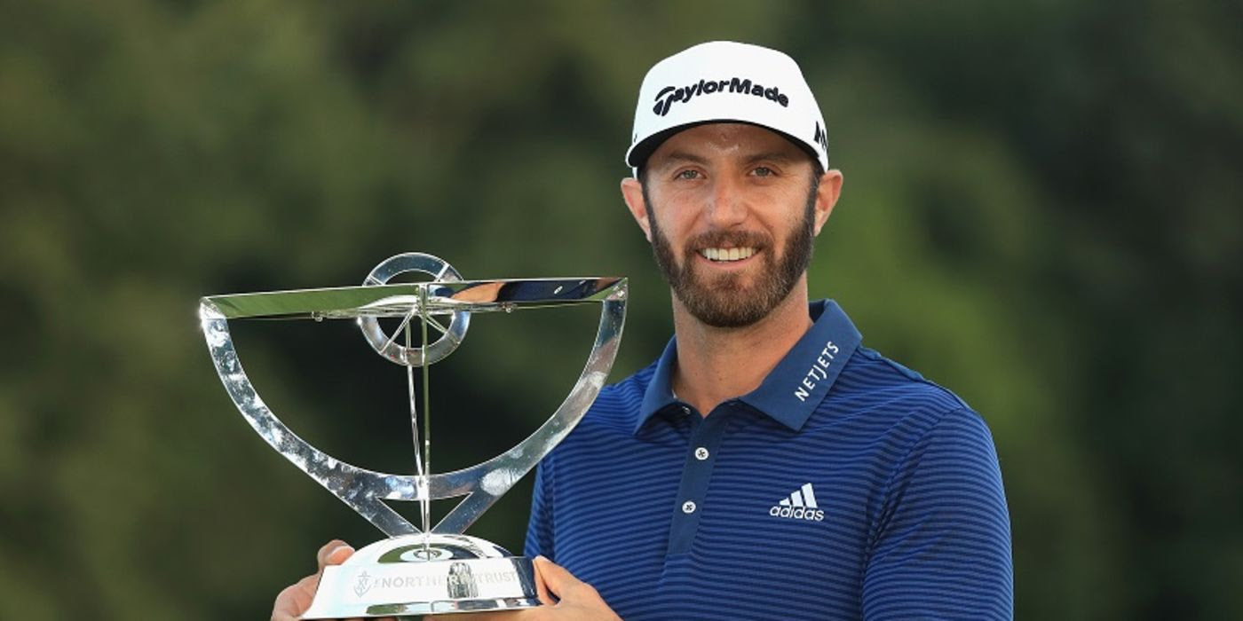 Dustin Johnson with Northern Trust trophy