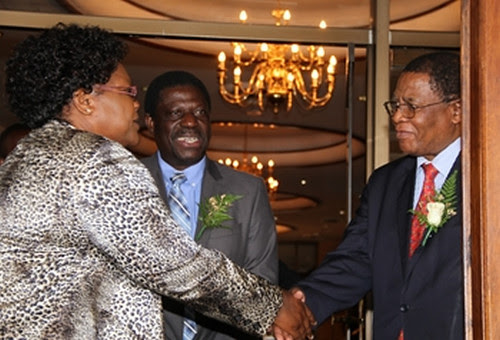 Republic of Zimbabwe Vice-President Joice Mujuru welcomes COMESA Secretary-General Dr. Sindiso Ngwenya and Commerce Minister Mike Bimha. They arrive in Harare on October 24, 2013. by Pan-African News Wire File Photos