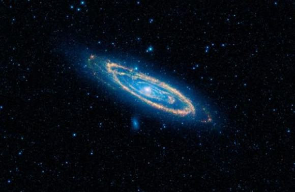 This is a false-color image of the mid-infrared emission from the Great Galaxy in Andromeda, as seen by Nasa's WISE space telescope. The orange color represents emission from the heat of stars forming in the galaxy's spiral arms. The G-HAT team used images such as these to search 100,000 nearby galaxies for unusually large amounts of this mid-infrared emission that might arise from alien civilizations. Credit: NASA/JPL-Caltech/WISE Team