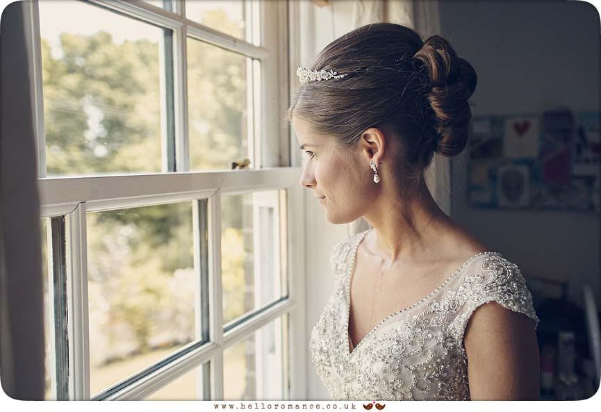 Bride looking out of window - www.helloromance.co.uk