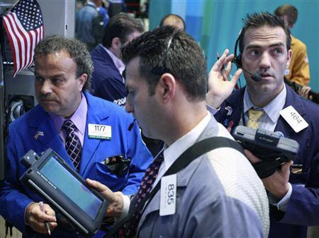 Traders work on the floor of the New York Stock Exchange, July 27, 2012. REUTERS/Brendan McDermid