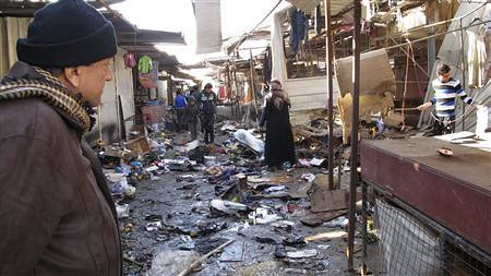 Iraqis look at damage done on Christmas Day bombings of 2013. The United States says it is sending hellfire missiles to the formerly-occupied Middle Eastern state. by Pan-African News Wire File Photos