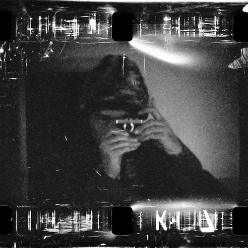 reflected self-portrait with Mikroma miniature camera by pho-Tony