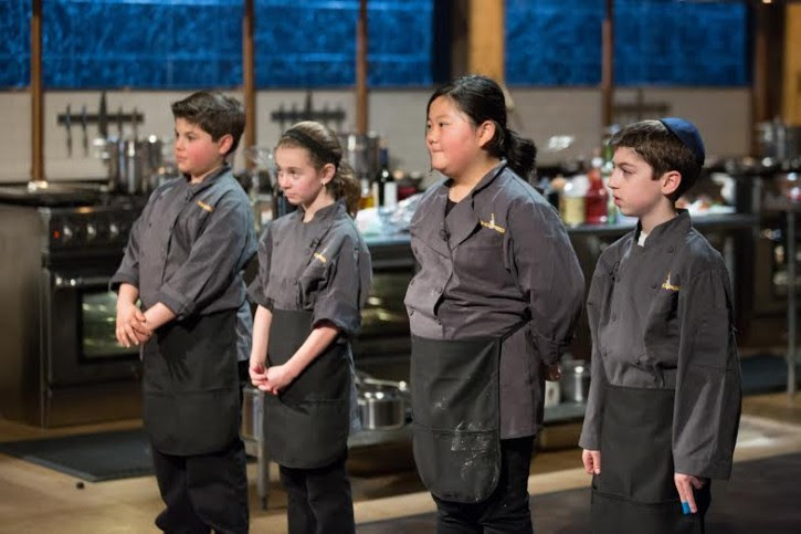 Chef contestants, Christopher Pappas, Lily Nichols, Mona Ziabari and Eitan Bernath stand together during a judging segment, as seen on Food Network's Chopped, Season 21.
