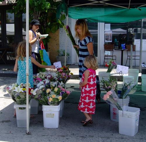 girls buying flowers