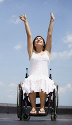 girl with outstreched arms in a wheelchair