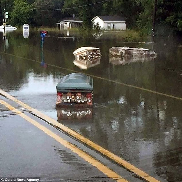 In shocking photos showing historic floods in Louisiana, caskets that had washed up from a graveyard floated down the street in Denham Springs