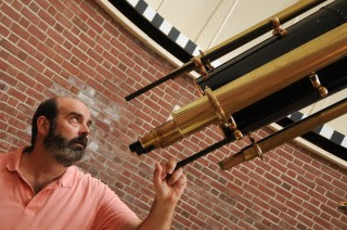 Associate Professor of Physics and Astronomy Ned Ladd peers through Bucknell's Clark telescope