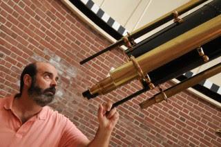Associate Professor of Physics and Astronomy Ned Ladd peers through Bucknell's Clark telescope