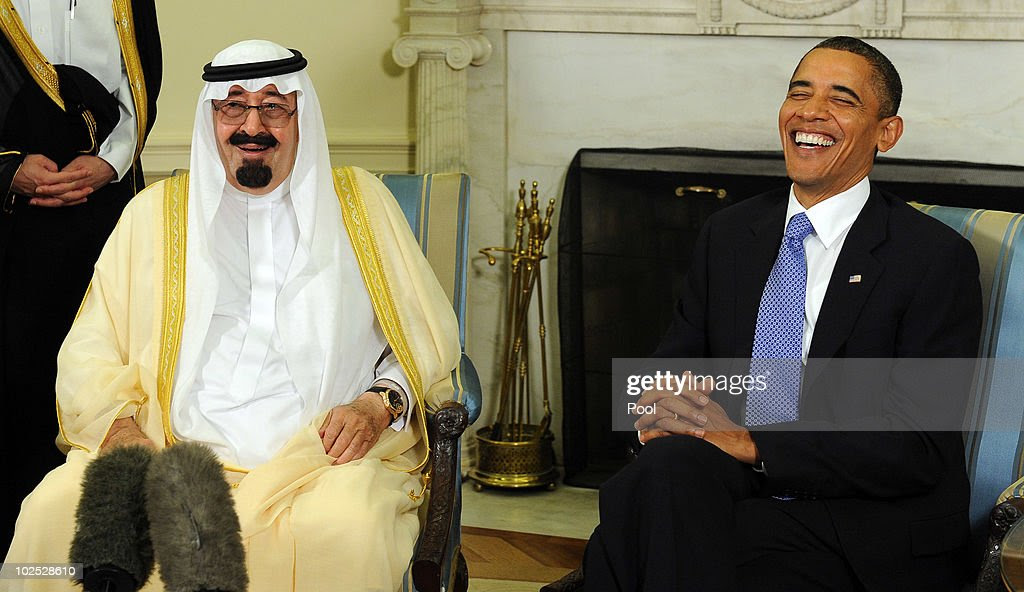 President Barack Obama (R) and Saudi Arabian King Abdullah Bin-Abd-al-Aziz Al Saud laugh as they speak to the media after their meeting in the Oval Office of the White House June 29, 2010 in Washington, DC. Obama and Abdullah spoke about the peace process in the Middle East.