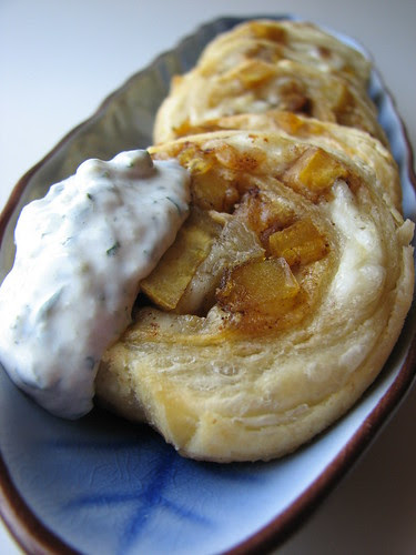 Plantain and Queso Fresco Puff Pastry Spirals with Roasted Tomatillo and Parsley Cream