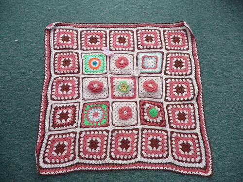 A beautiful Blanket, gorgeous Flower Squares.
