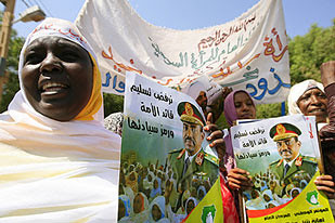 Women demonstrate in support of the Sudan government. The central African state, the continent's largest, has become one of the emerging oil-producing countries. by Pan-African News Wire File Photos