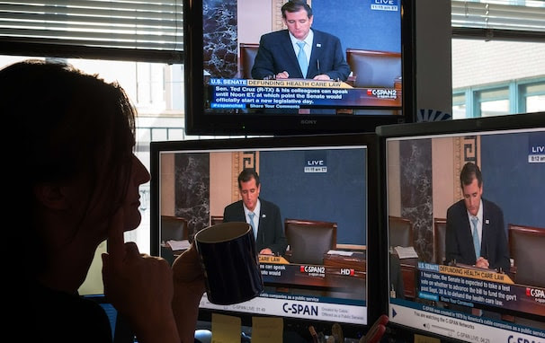 A journalist watches C-SPAN TV on computer screens showing US Senator Ted Cruz (R-TX) on September 25, 2013 in Washington,DC. Most US senators expect to pass a stopgap spending bill this week, but one lawmaker is so against it he took to the Senate floor -- for 19 hours and counting. Few knew that Senator Ted Cruz would still be engaged in his talkathon, much less even awake, on Wednesday morning to oppose the temporary budget. But such is his fierce opposition to President Barack Obama's signature health care law, whose funding is part of the bill, that he held the Senate floor through the night, delivering one of the longest Senate speeches since precise record-keeping began in 1900. The conservative first-term lawmaker was voicing what he said is America's deep discontent for the law known as