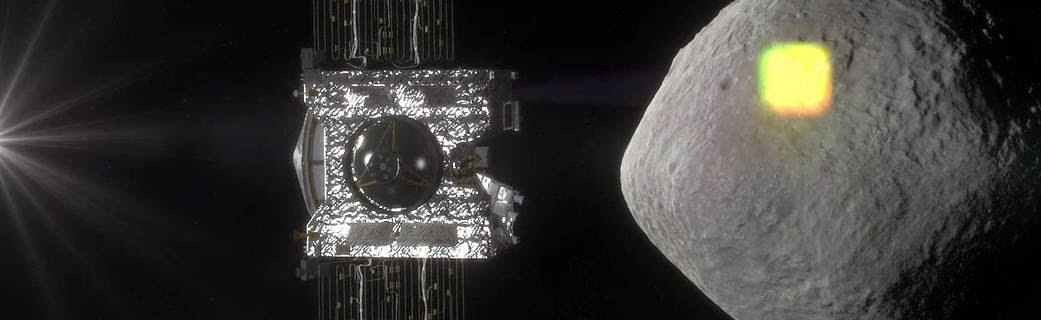 spacecraft projecting light onto asteroid