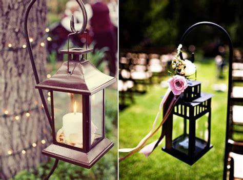 Hang lanterns on shepherds hooks along your wedding aisle