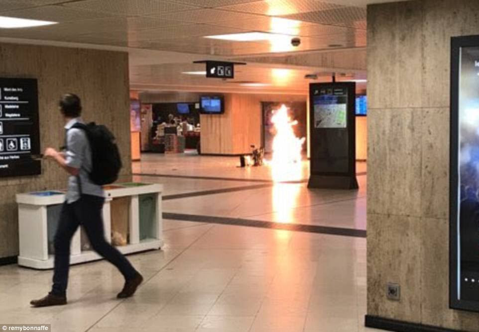 A suspected suicide bomber who allegedly shouted 'Allahu Akbar' before triggering an explosion at Brussels Central Station has been gunned down by soldiers on Tuesday evening. This photo purports to show the explosion in the station