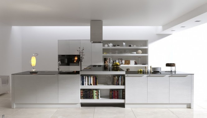 If you are blessed with a large amount of floor space for your culinary endeavors, consider making the layout of your space the special feature, like this unusual T-shaped creation.