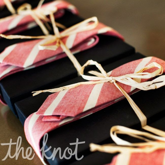 hmm..kinda like the idea of wrapping the groomsmen gifts in their tie...