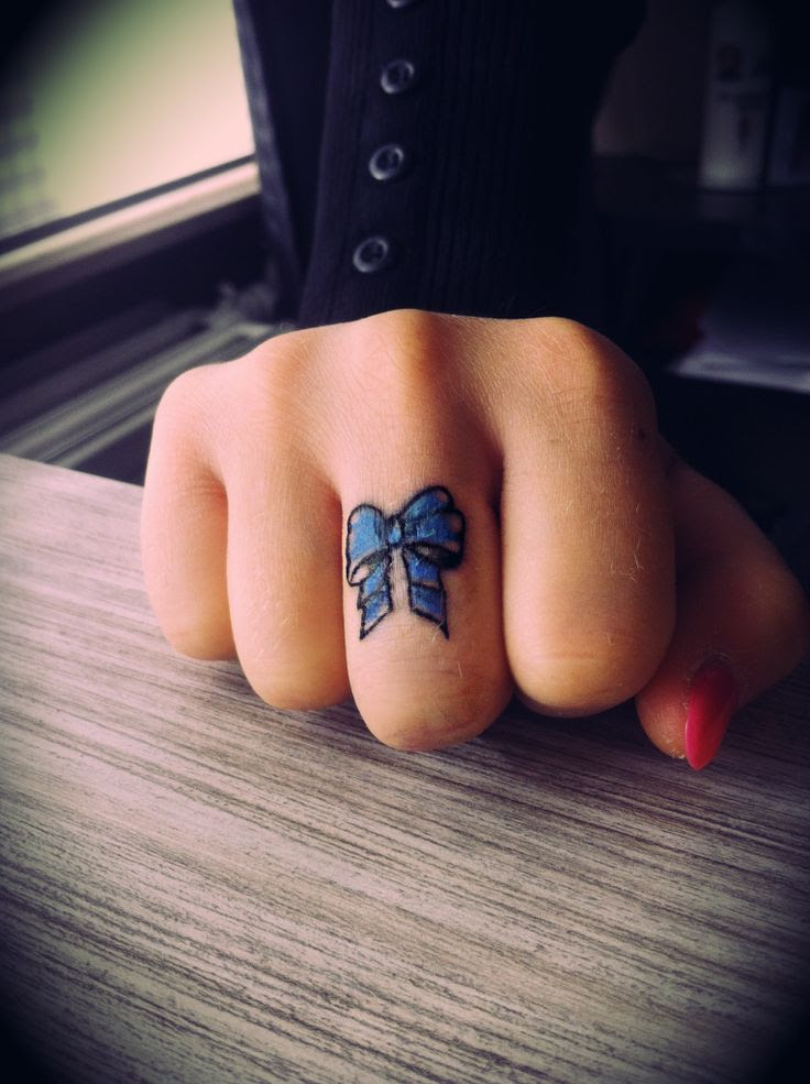 blue bow tattoo on my finger!