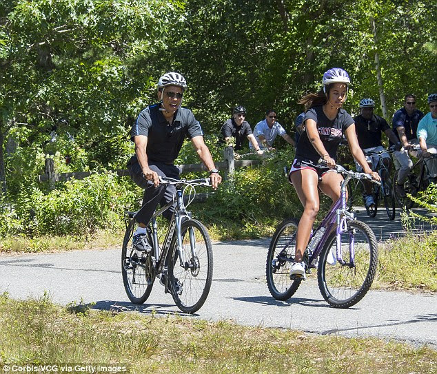Obama and daughter Malia bike riding on the Correllus State Bike Path outside of West Tisbury, Martha's Vineyard, in August 2014