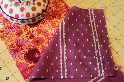 lay fabrics with right sides facing one another