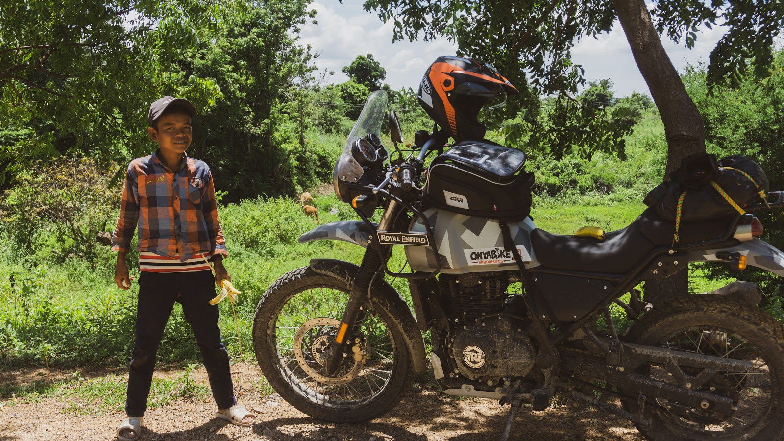 a motorbike rider posing for a shot - adventure riders