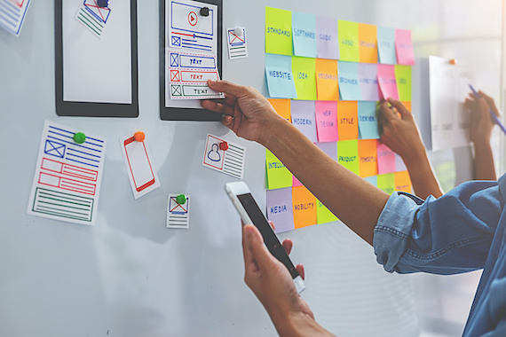 Experience design: Wireframes and sticky notes on a whiteboard