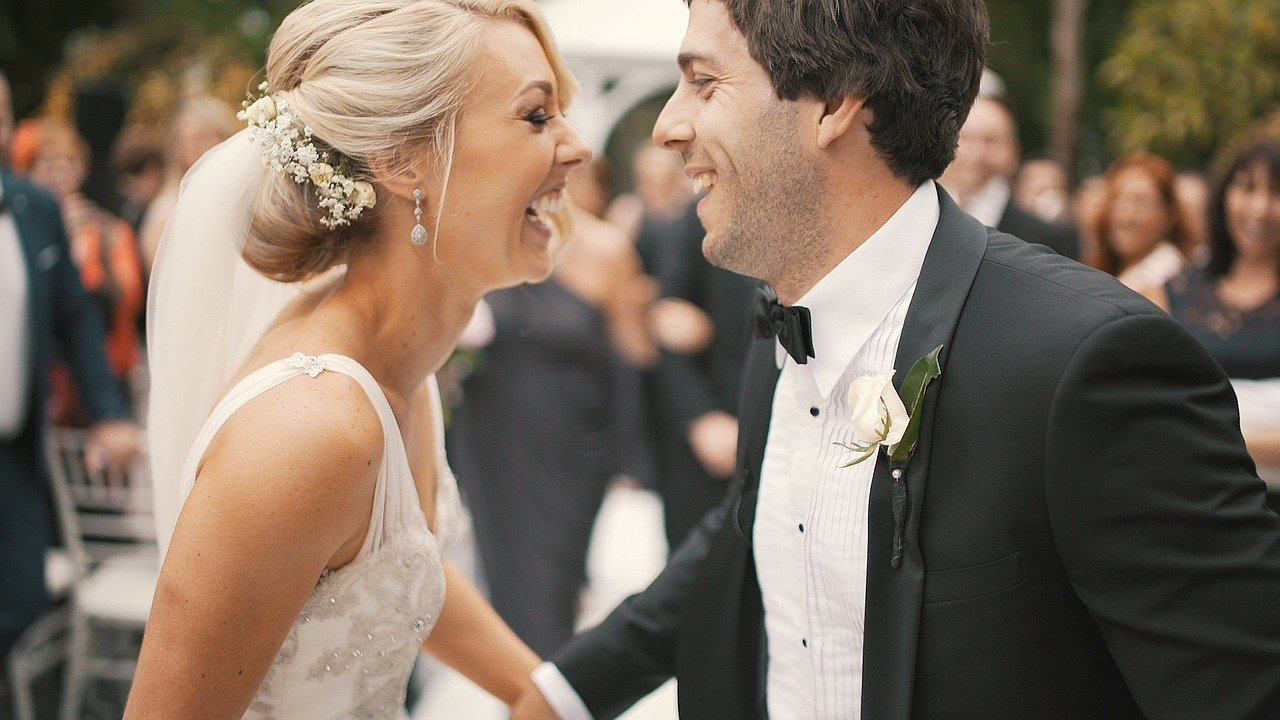 Couple laughing at their wedding