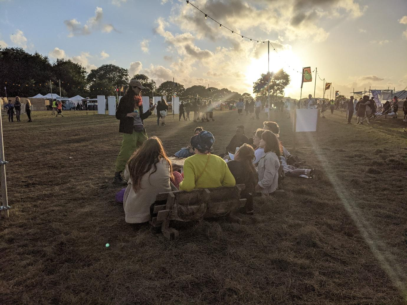 A picture containing grass, sky, outdoor, people  Description automatically generated