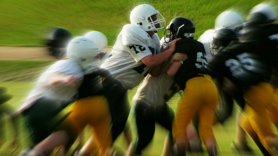 Football - close up of a tackle.