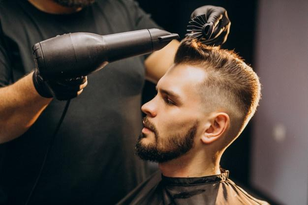 Handsome man at a barber shop styling hair  Add Volume To Hair