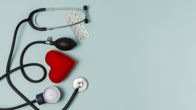In the image shows a stethoscope, a blood pump and some anti-biotics which all link with the heart