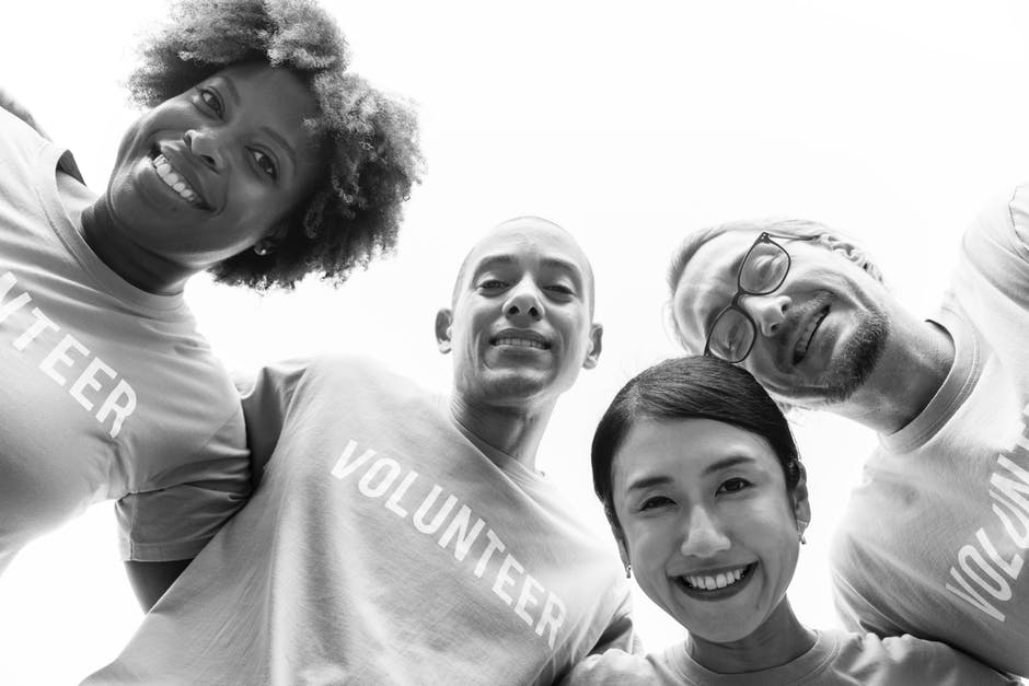 Grayscale Photography of Group of People Wearing Volunteer-printed Shirt