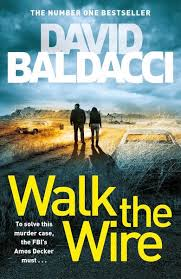 Book cover: David Baldacci: Walk the Wire; image of two people walking a lonely desert road, with an abandoned car on the side of the road