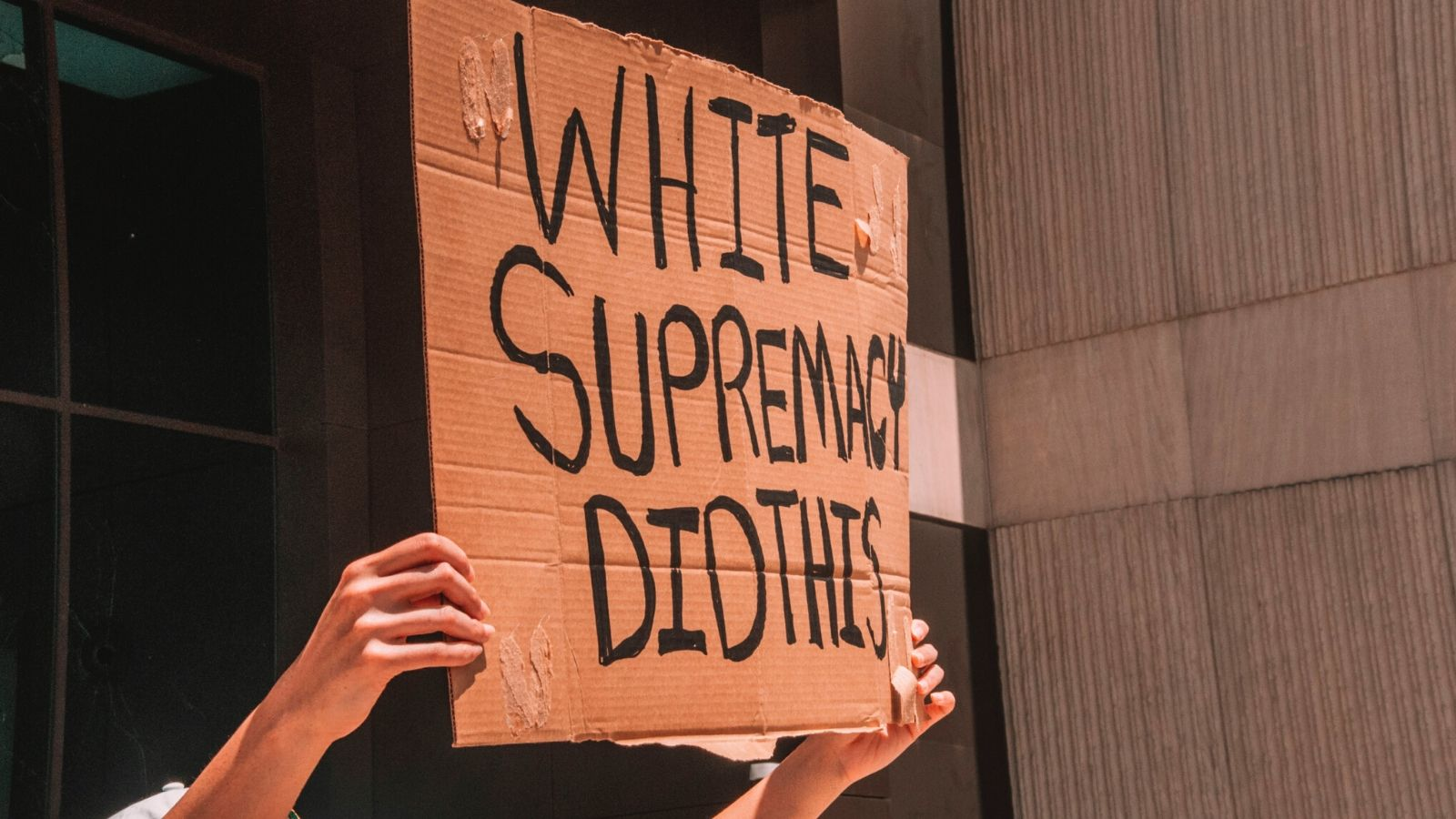 A sign being held up against white supremacy at Black Lives Matter protest.