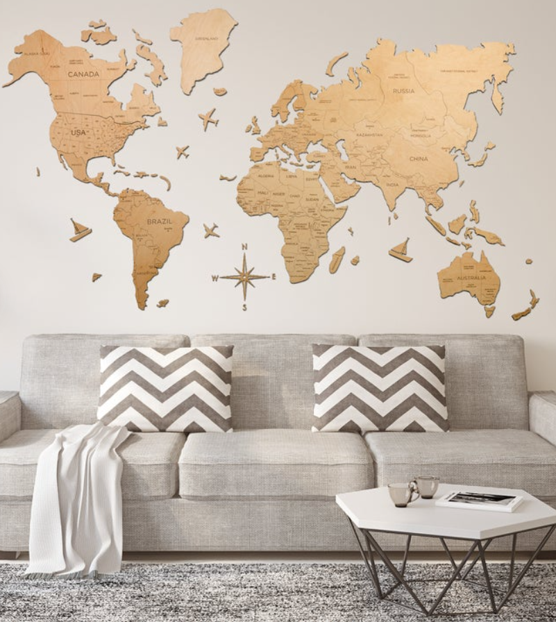 wood decal map above grey living room sofa and grey speckled rug