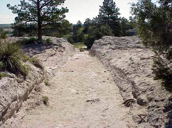 A picture of wagon ruts in Guernsey State Park in Wyoming.