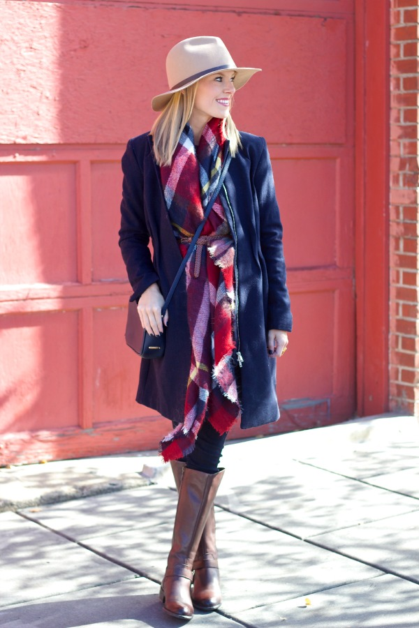 blanket scarf worn belted under a coat