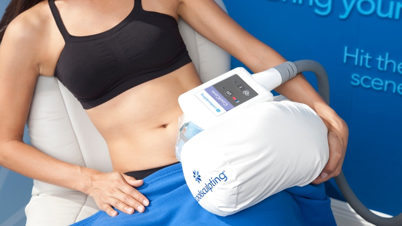 Woman receiving CoolSculpting treatment