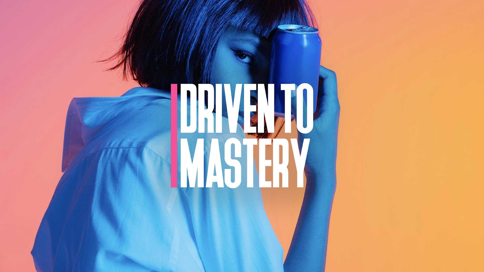 Woman Holding Can labeled Driven to Mastery