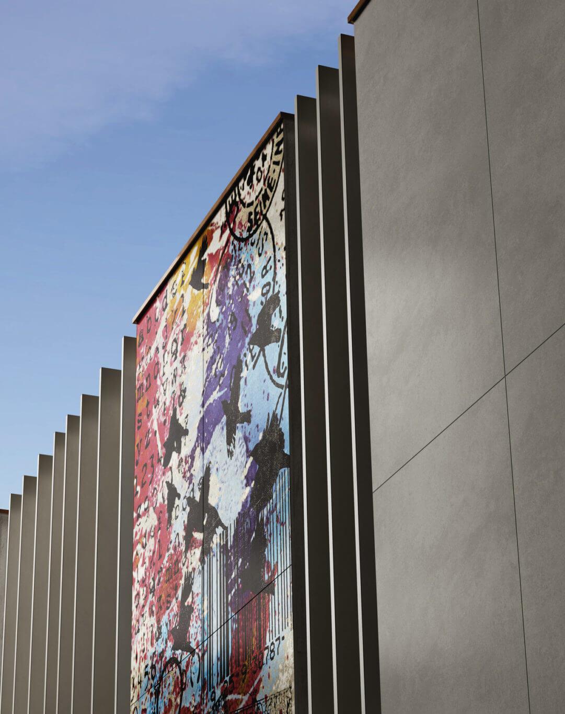 Building façade with custom gauged porcelain tile panels/slabs