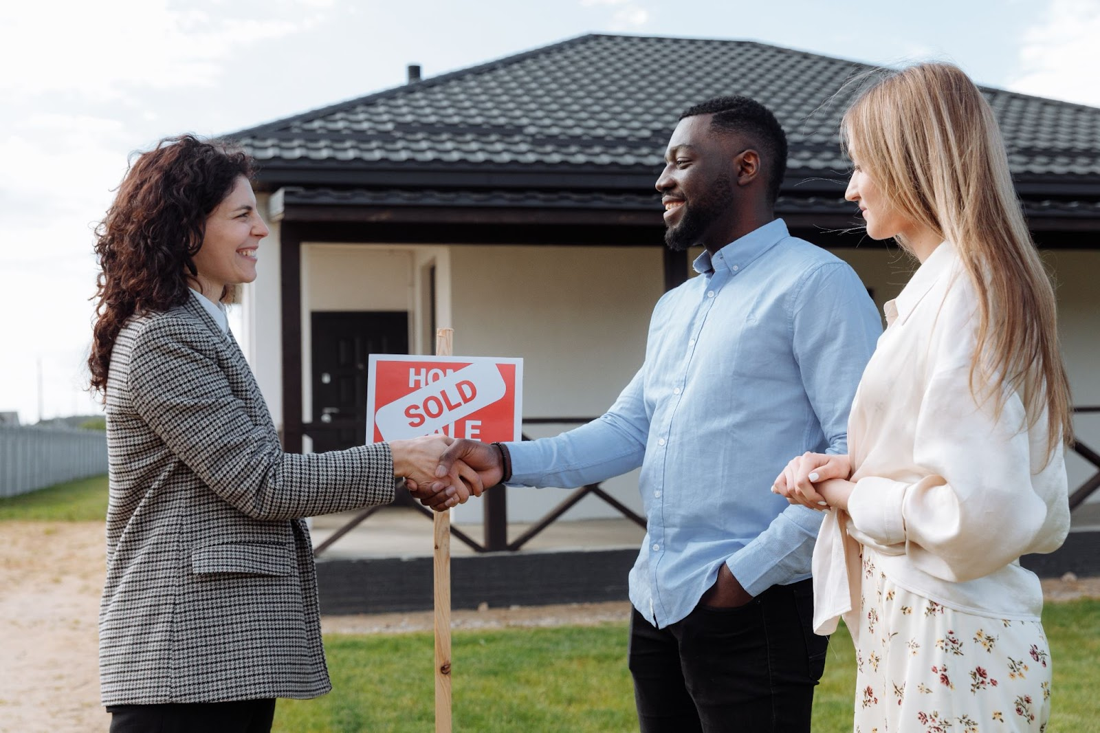 Real Estate Agent Closes a Sale with Buyers