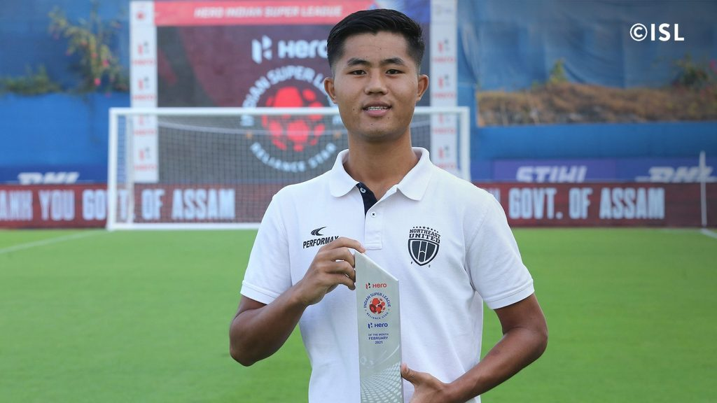 Apuia with the ISL Emerging Player of the League award