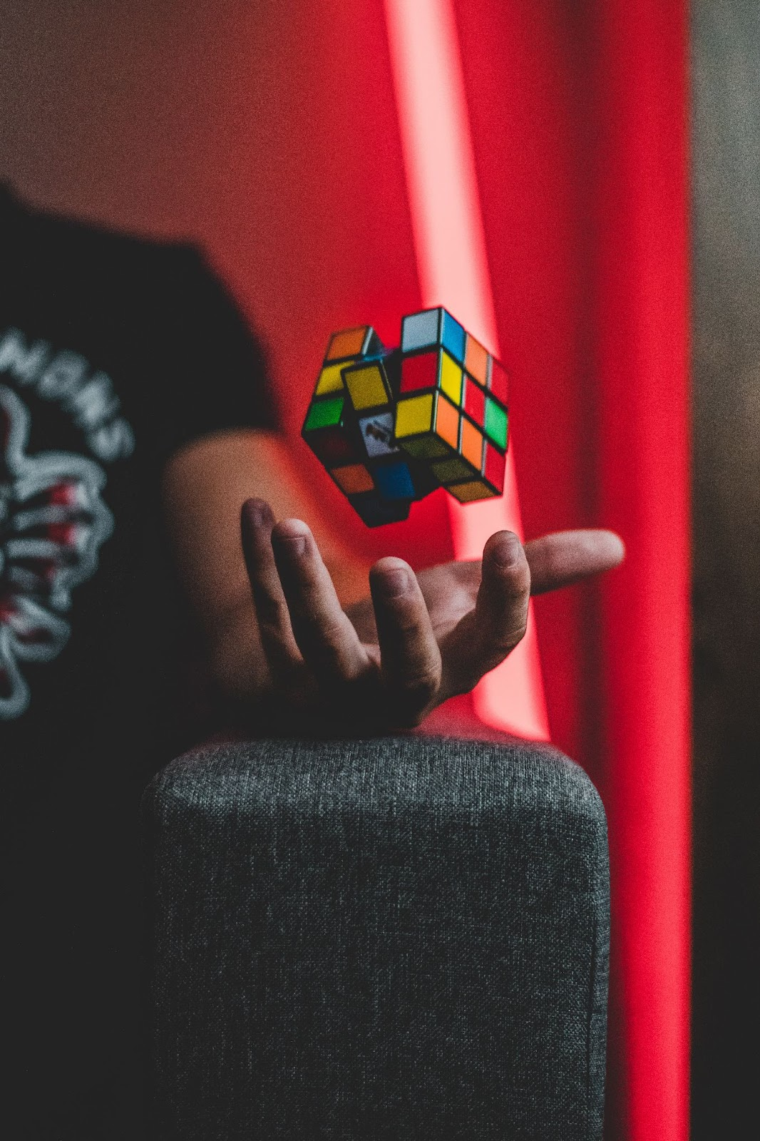 rubik's cube in human hand