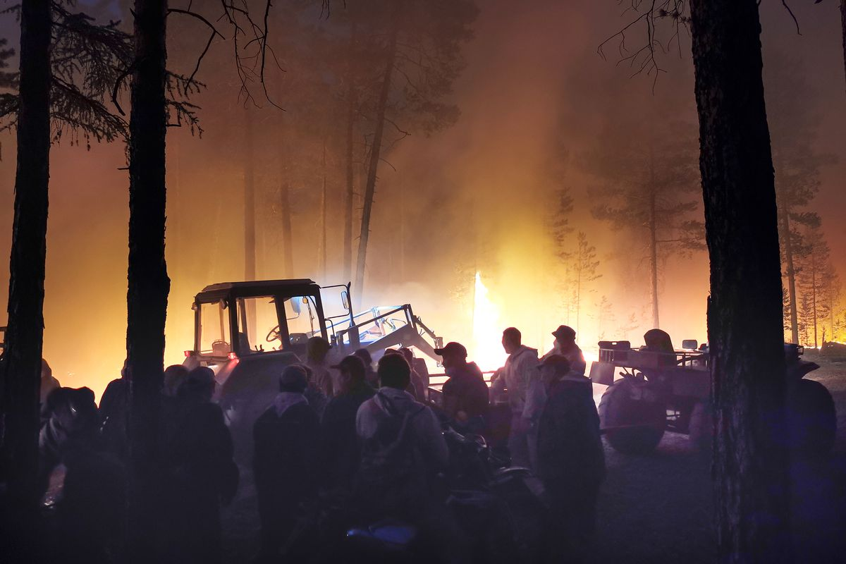 Volunteers prepare to douse a forest fire in the republic of Sakha.
