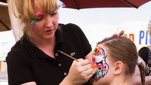 Image result for kids getting their face paint by people