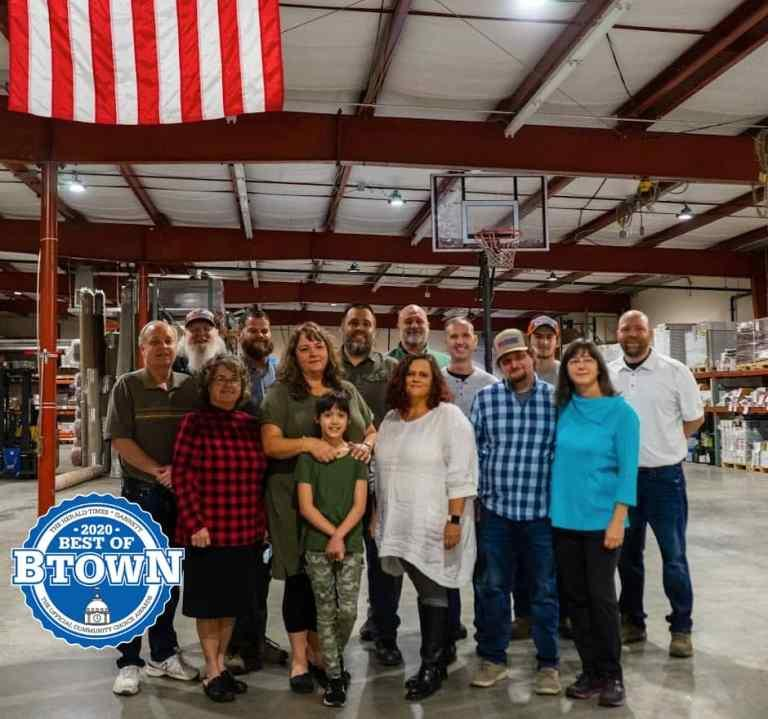 The family and staff of Bounds Flooring gathered in a warehouse posing for the 2020 Best of Btown awards